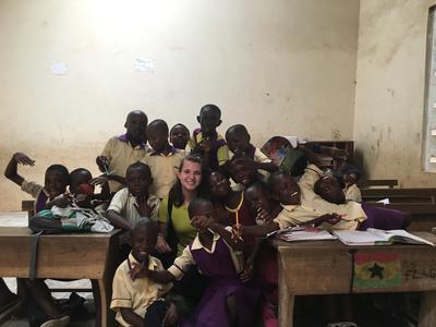 Volunteer in class with children in Ghana