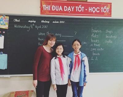 Gina with two students during her Teaching Project