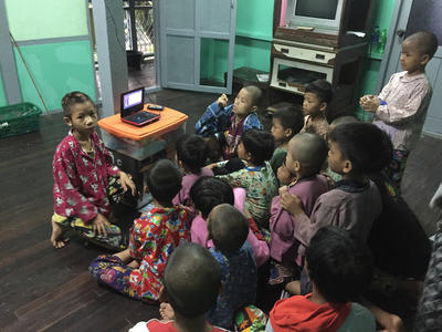 Children at a Care placement watching a DVD together