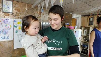 Indigo with a child at her Care placement