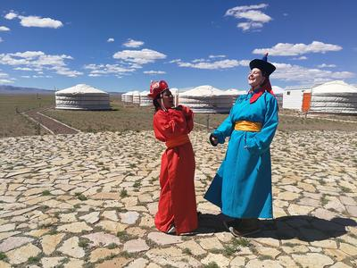 Volunteers wearing traditional Mongolian dress