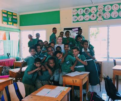 Teaching volunteer with her students in Fiji