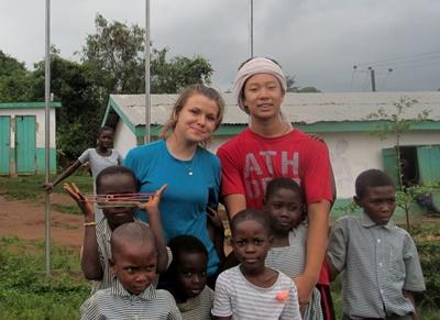 Jade and another volunteer spend time with children at their placement