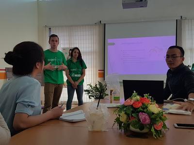 Medicine volunteers giving a presentation in Vietnam