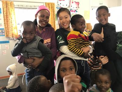 Jenny with children from her Care and Community placement