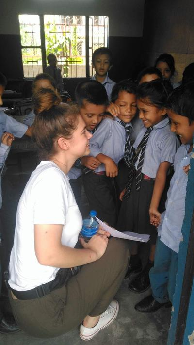 Jessica working with children at her placement