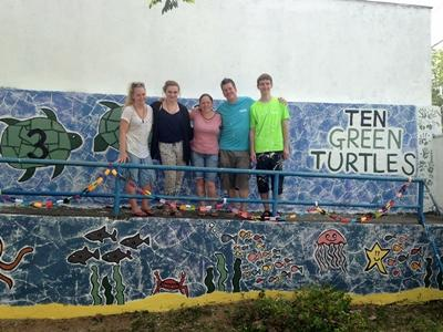 Volunteers with the mural painted at their placement