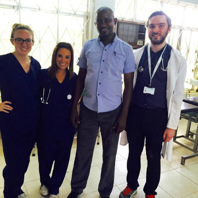 Volunteers with local Tanzanian doctor at a hospital