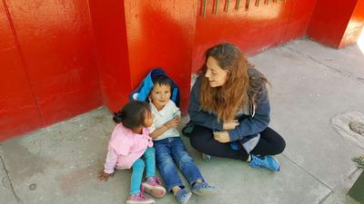 A volunteer spends time with local children at her kindergarten placement