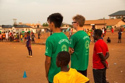 Volunteers watching a football game