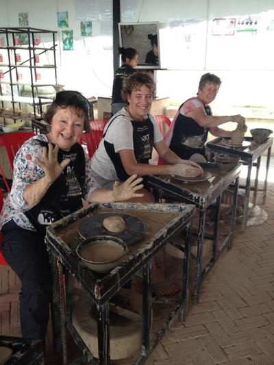 Judith participating in a pottery class