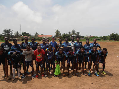 Julien with a local football team