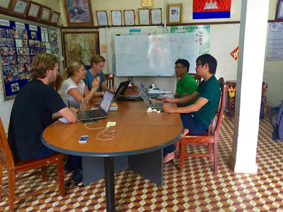 Micro-finance volunteers having a meeting with the staff