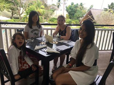 Care volunteers enjoy a meal together in Fiji