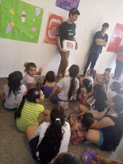 Medicine volunteers teaching the children about oral hygiene