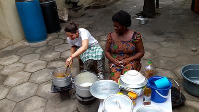 Volunteer assisting with meal preparation in Ghana