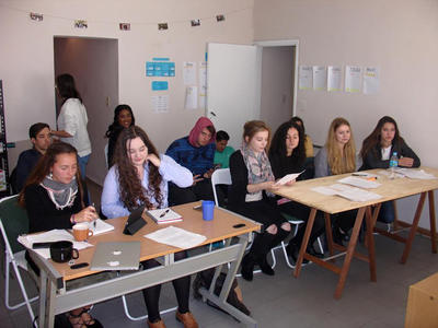 Volunteers attend a Spanish class together
