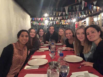 Volunteers eat a meal together in Argentina