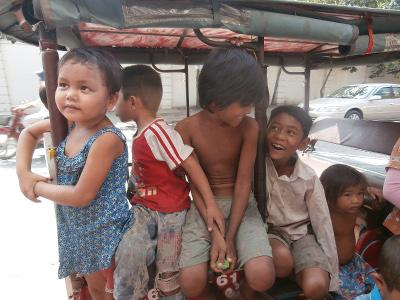 Local Children Sitting on a Tuk Tuk
