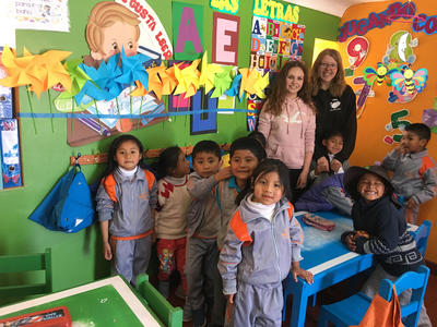 Volunteers in a classroom with the children