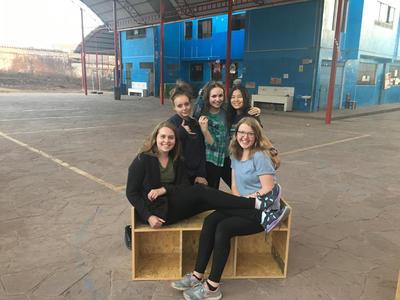 Volunteers taking a break from building new furniture