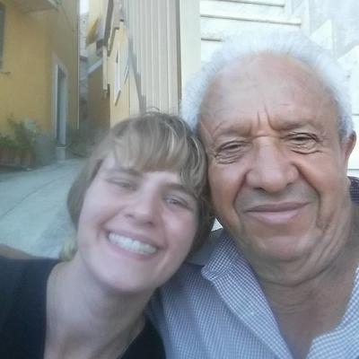 Melissa posing with a man from her Refugee Project