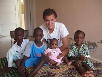 Volunteer Michael Nicholas his the children at his host family in Senegal