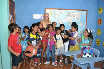 Volunteer with students in the classroom