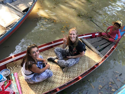 Volunteers taking a boat trip in Cambodia