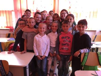 A Teaching volunteer with her class of students in Romania