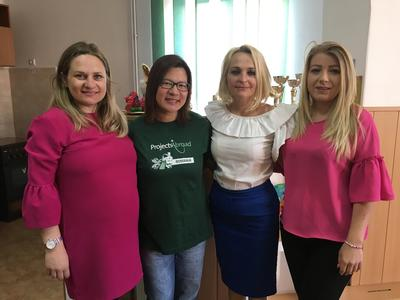 A volunteer with teachers from a local school in Romania