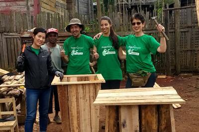 Volunteers building rubbish bins