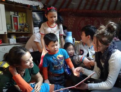 Reading to children in Mongolia
