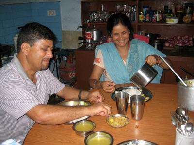 Host family eating daal bhaat