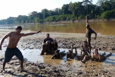 Conservation volunteers having fun near a river in the Amazon