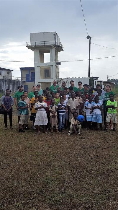 Conservation staff and school children before a beach clean-up in Sint Bight Belize