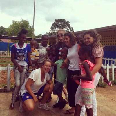 Care & Community volunteers with local children at their placement