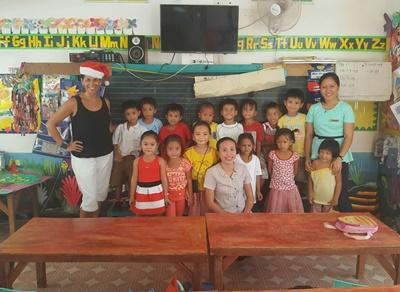 Volunteer with staff and children at her Teaching placement