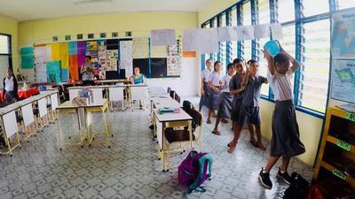 Volunteers run educational activities with local school children