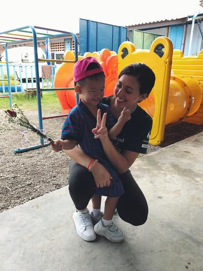 Tania with a young boy in Thailand