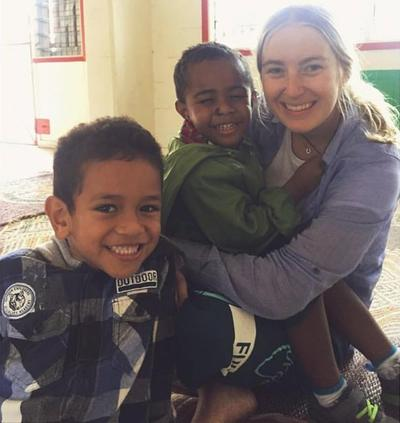 Volunteer with children from her kindergarten placement