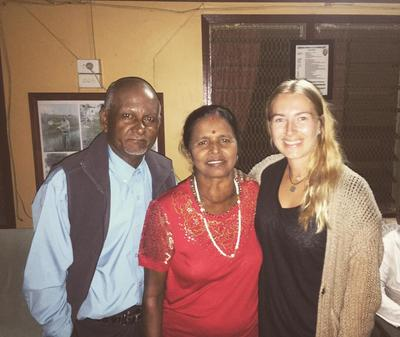 Volunteer with her Fijian host family