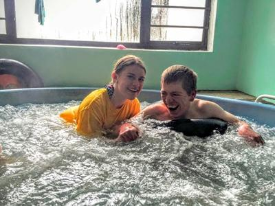 Helping a patient with physiotherapy in the Jacuzzi