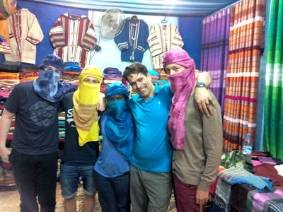 Putting on headscarves at a local fabric store
