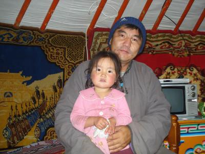Nomad host father and child